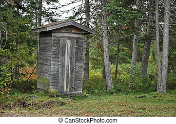 weathered outhouse in woods - old weathered outhouse in...