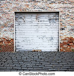 roll up garage door on brick wall