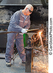 old welder perfecting his work