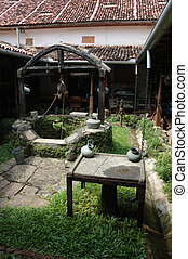 Old well in the courtyard of old colonial house, Ceylon