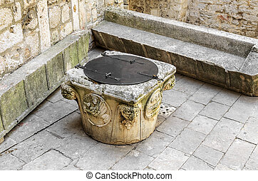 Old well in the courtyard of the castle.