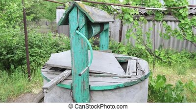 Old well in the yard - Concrete old well in the yard of the...