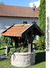 old well to collect water in a country house