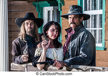 Portrait of three old west citizens