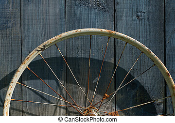 old wheel from a bicycle on a wooden background