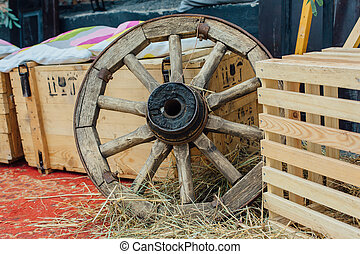 Old wheel from a cart in shed