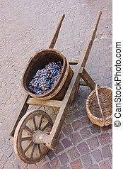 old wheelbarrow with grape