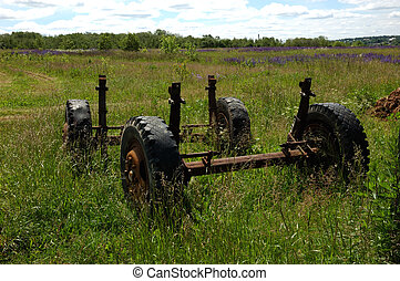 Old wheels of trailer on the meadow