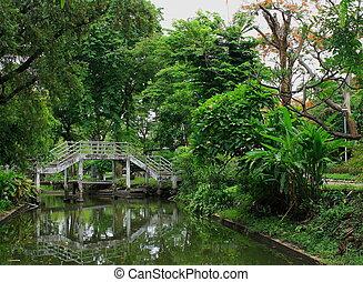 Old white bridge in the park