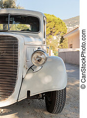 Old white car on a rural road