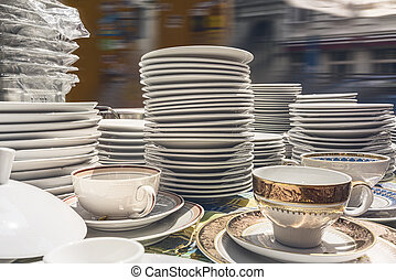 old white dishes on a flea market