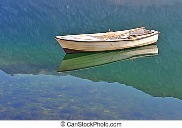 Old white fisher boat in the lake
