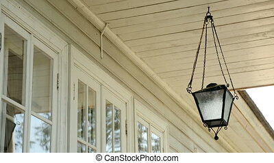 old white lamp hanging on the ceiling outside