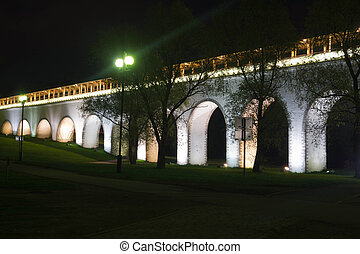 white stone bridge in the park at night