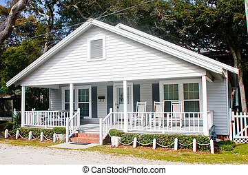 Old White Wood Cottage with Rockers on Porch