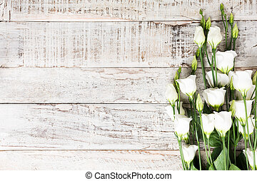 wooden background with bouquet of white flowers