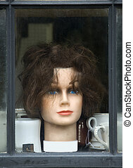 old wig display in a store