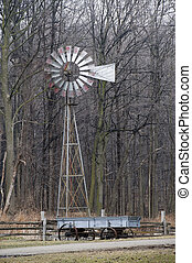 old wind mill with wagon
