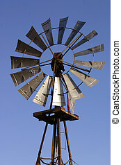 Old Windmill - An old windmill still pumping water on a...