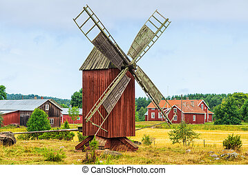 Old windmill in a rural landscape