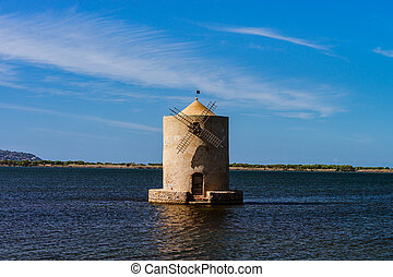 Old windmill in italy, tuscany. Standing in the water