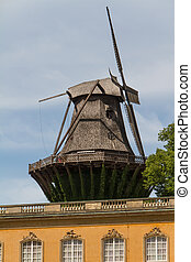 old windmill in park sanssouci palace in Potsdam, Germany