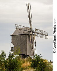 Old windmill in summer on a cloudy day