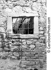old window grille of a ruined castle