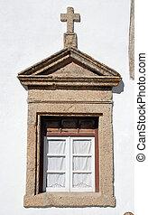 old window in stone rural church, Portugal.