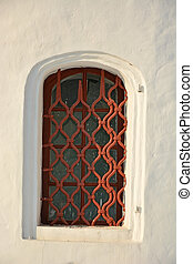 Old window of the ancient church. Closeup view