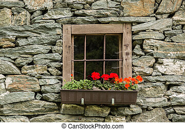 Old Window of the stone house in Alps