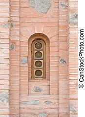 Old window on a brick wall.
