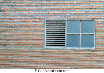 Old window on brick wall