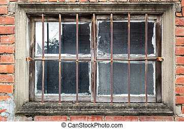 old window on red brick wall