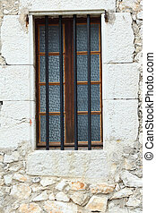 Old window on the wall