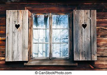 Old window shutters in wooden wall - Window of old, wooden...