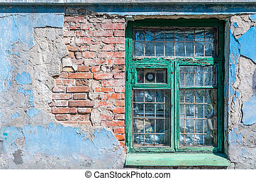 old window with a broken brick wall and peeling paint