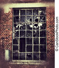 old window with broken glass in vintage look
