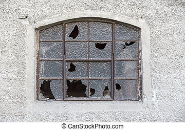 Old window with broken glass
