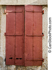 old window with  closed wooden shutters
