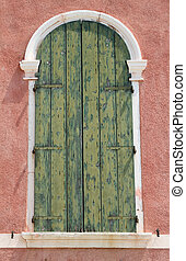 old window with green shutter