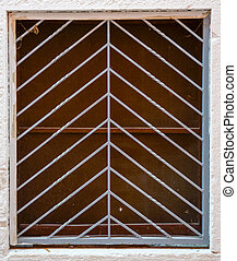 old window with metal bars