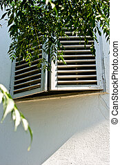Old window with sun shutters