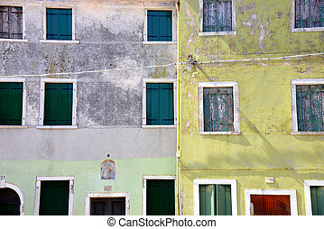 Old windows collection in Burano island.