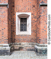 Old windows in red brick wall