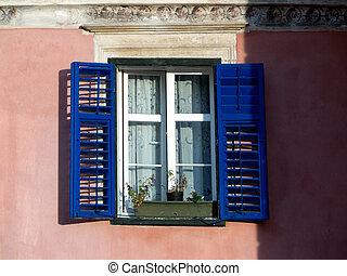 Old windows on plastered brick wall