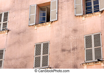 Old windows on the wall of a house