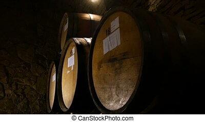 Old Wine Barrels In A Wine Cellar