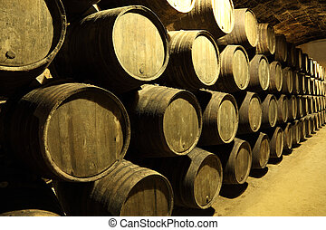 Old wine cellar full of wooden barrels