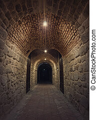 Old wine cellar tunnel at the Hincesti winery underground of the Manuc Bei mansion in Moldova. Traditional moldavian rural subterrane stone vault reconstructed with modern motif. Creepy dark details.